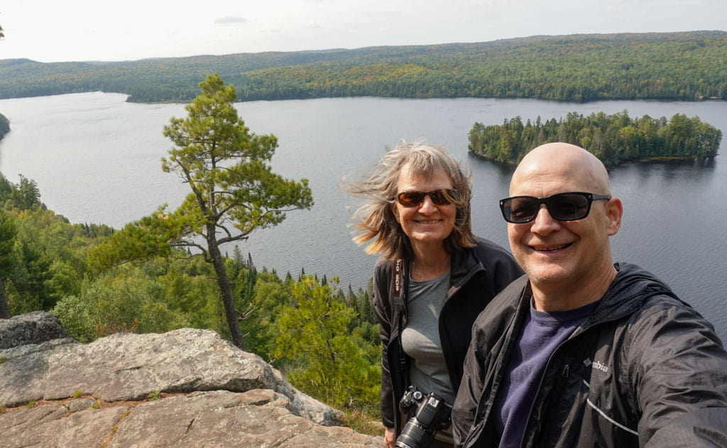 Couple on ridge overlooking Whitefish Lake Algonquin Park