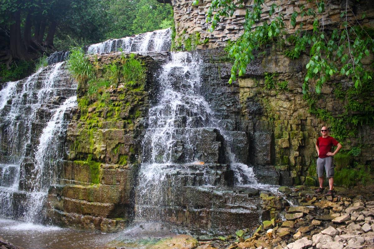 Person beside Jones Falls Grey County Waterfalls