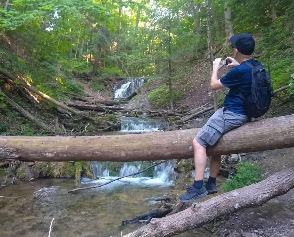Person on log Weavers Creek Falls