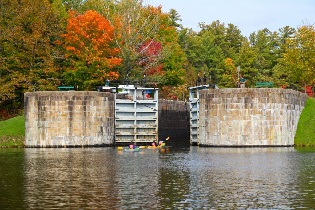 Lock doors opening to 3 kayakers