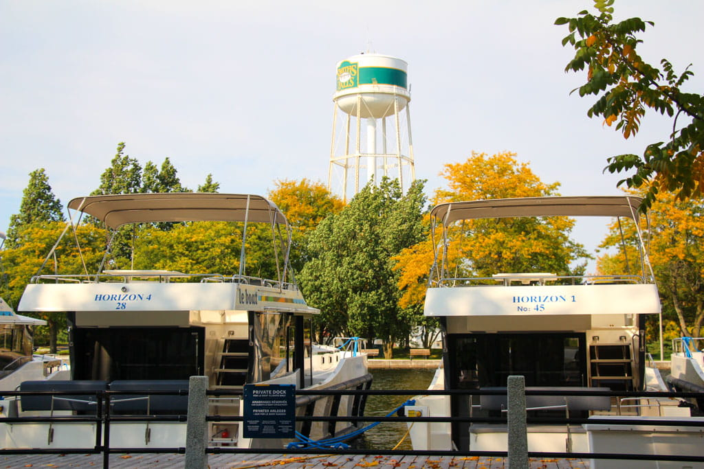 2 boats moored foreground Smiths Falls watertower background
