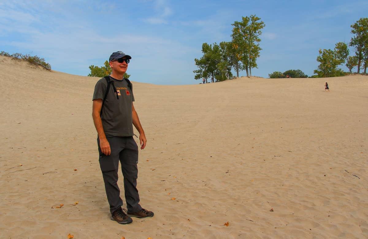 Man foreground huge sandbank background Sandbanks Provincial Park