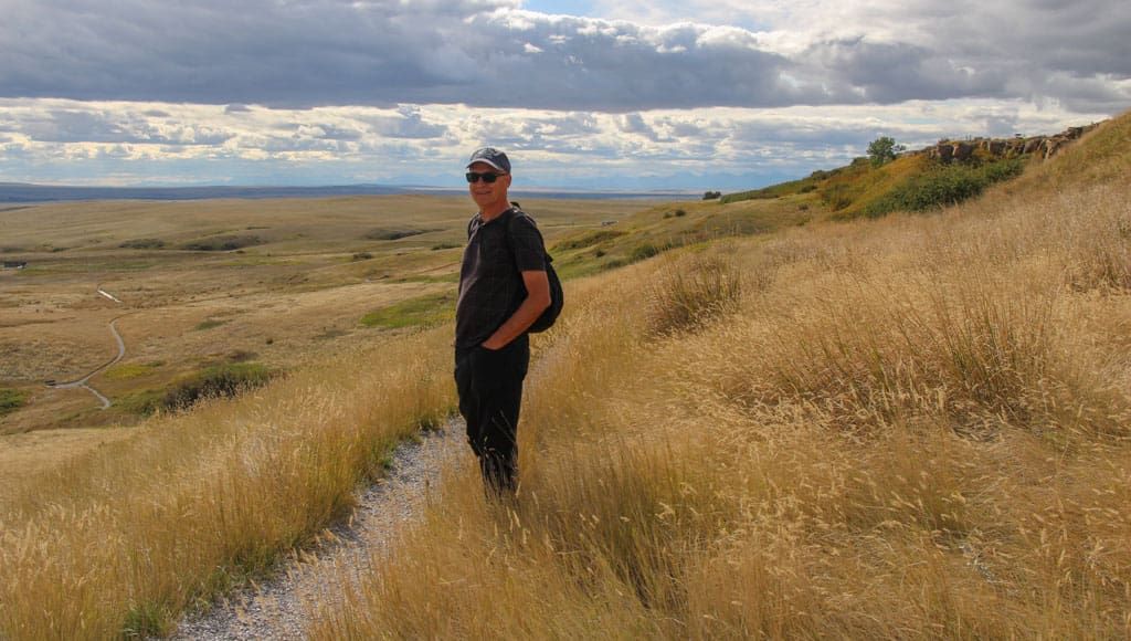 Person on grassland trail Head-Smashed-In Buffalo Jump