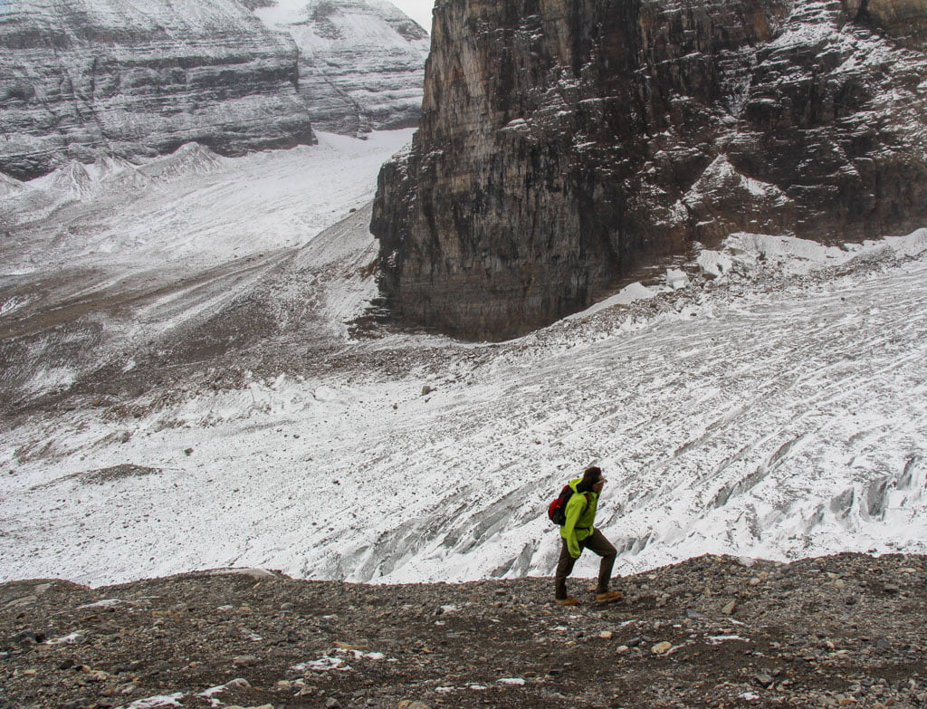 Hiker at side of glacier - Plain of Six Glaciers