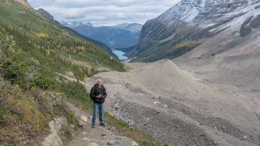 Standing on Plain of Six Glaciers Trail with Lake Louise in background