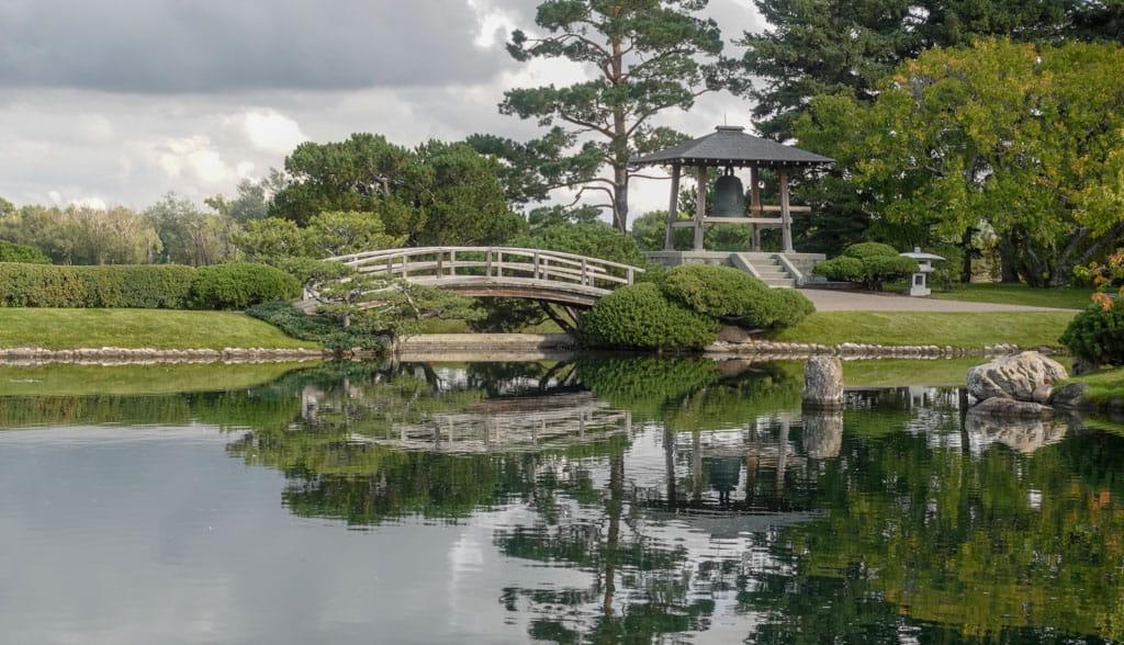 Pond reflecting bridge and bell at Nikka Yuko Japanese Garden