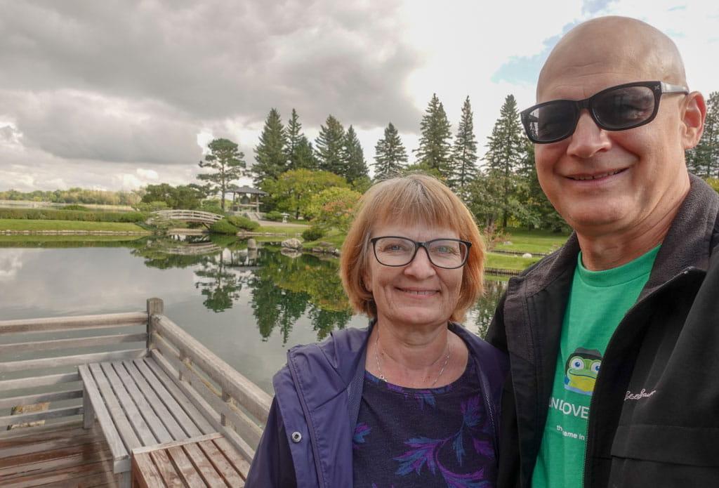 couple with Nikka Yuko pond in background