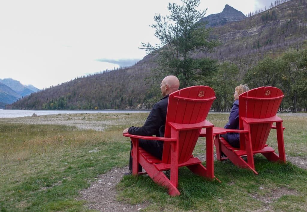 Enjoying red chairs placed in Waterton Lakes
