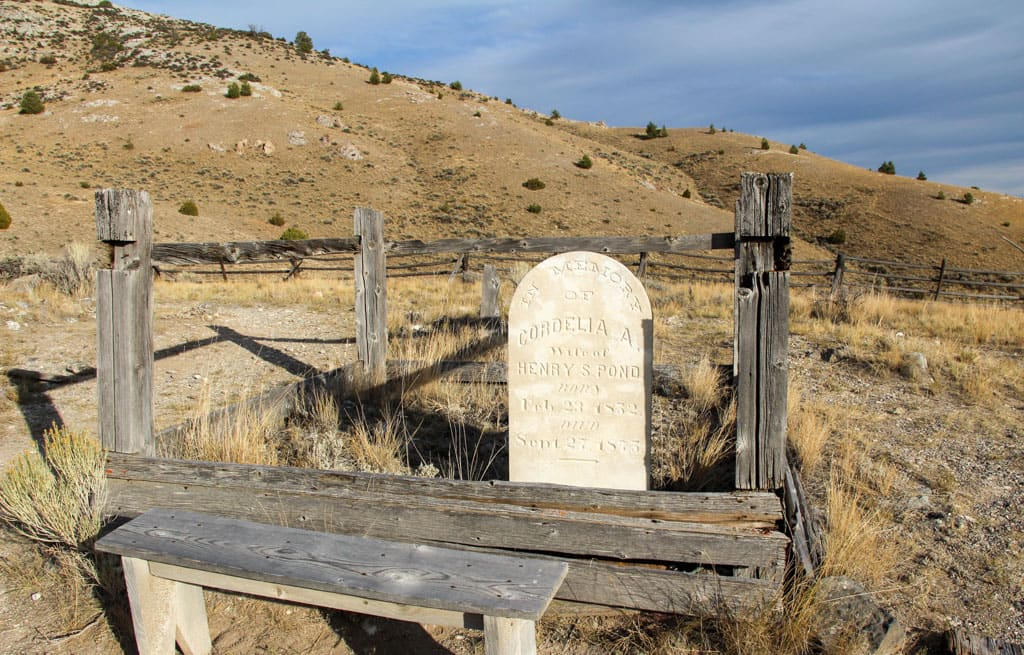 Grave marker surrounded by fencing Bannack Cemetery