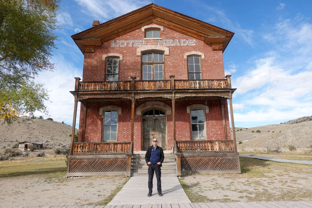 Person in front of Bannack's Hotel Meade