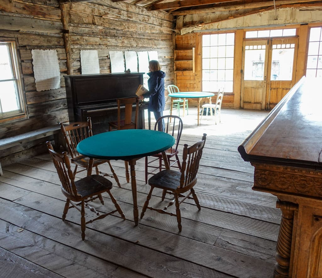 Card table, bar, person standing at piano Skinner Saloon
