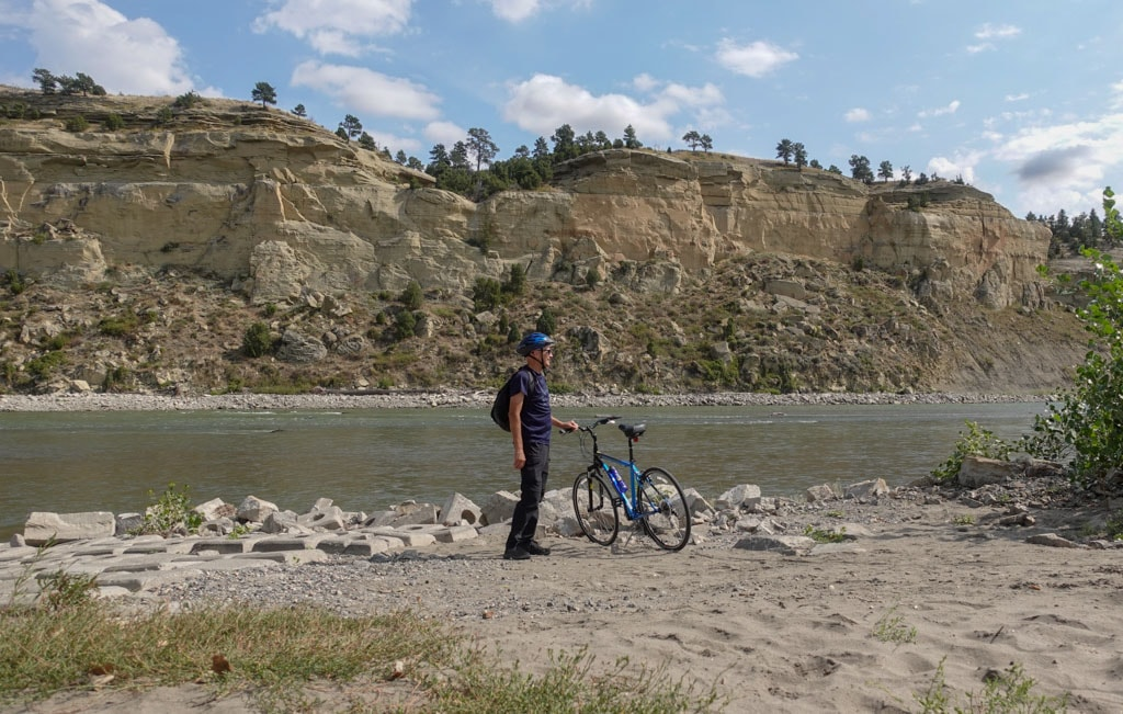 Standing with bike edge Yellowstone River Billings