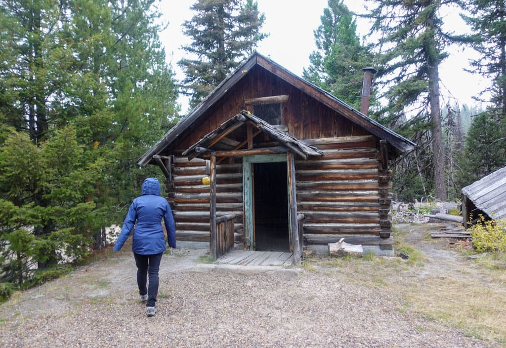 Person walking to intact cabin