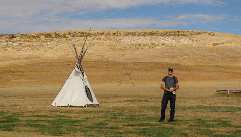 Teepee foreground cliff ridge background First Peoples Buffalo Jump