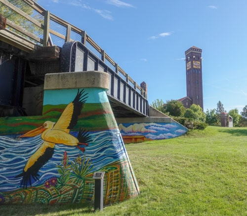 Murals painted on concrete bridge supports Great Falls
