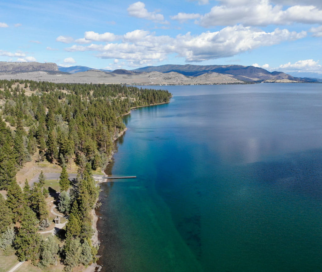 Aerial view blue-green waters of Flathead Lake
