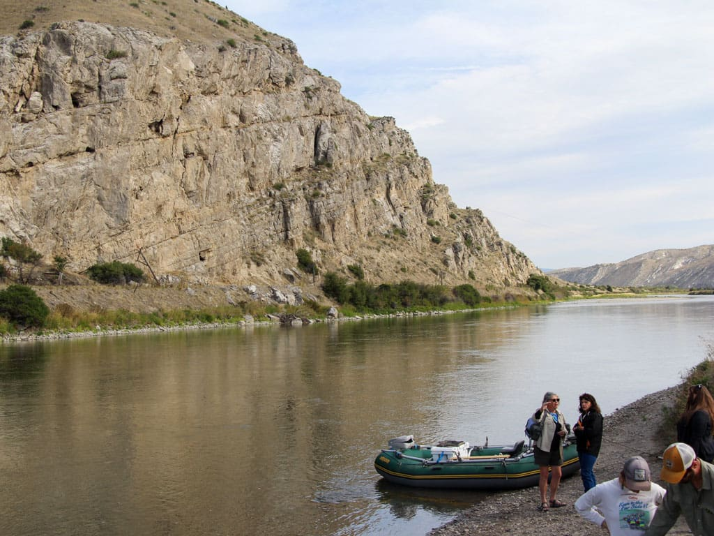Boat and people shore of Missouri River