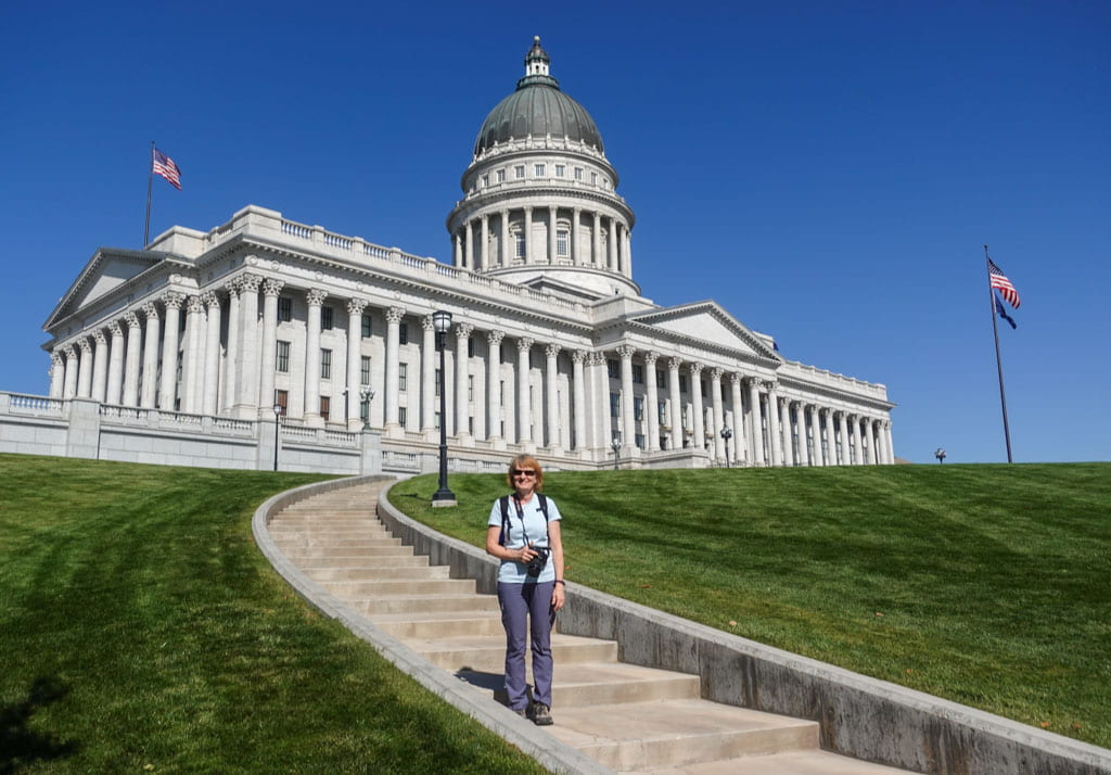 Person standing on steps of Capitol Salt Lake City