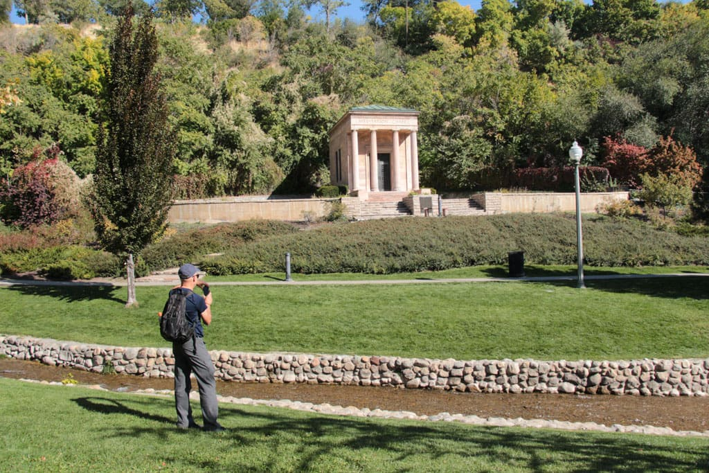 Person taking photo of chapel across Memory Grove Park