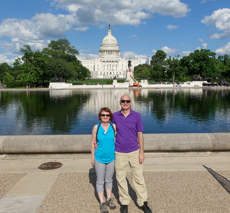 Couple in front of Reflecting Pool and US Capitol