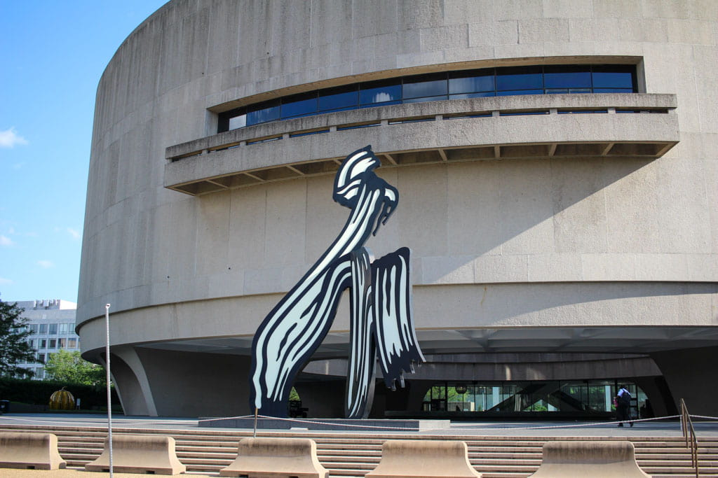 Modern art in front of cylindrical Hirshhorn Museum