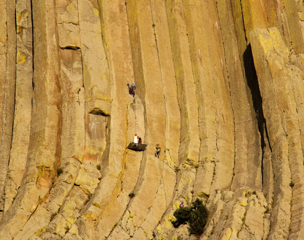 People shown climbing Devils Tower