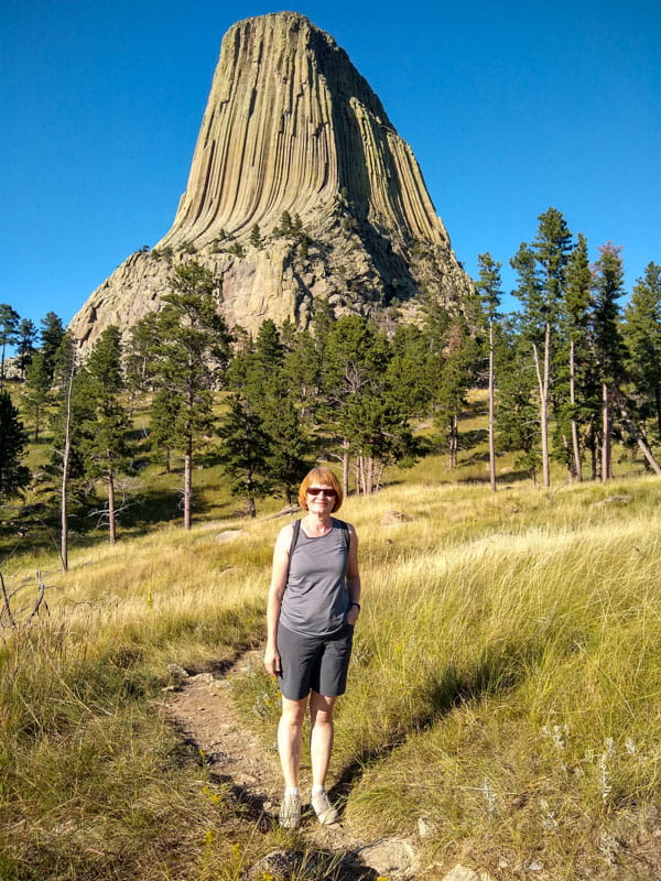 Person in grasslands on Devils Tower hiking trail