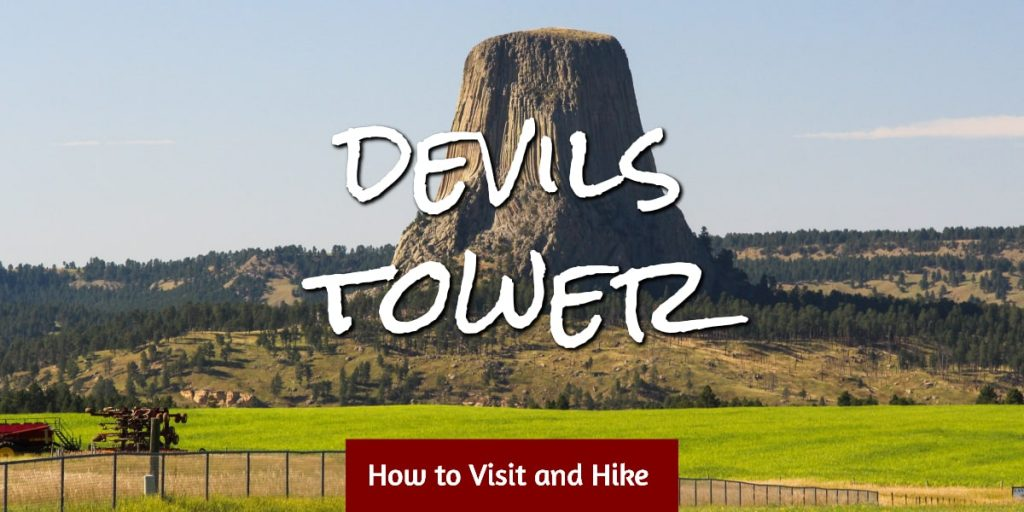 Green field with Devils Tower in background