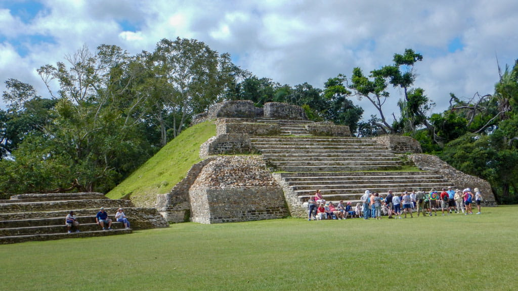 Group of visitors at base of Altun Ha Structure A3