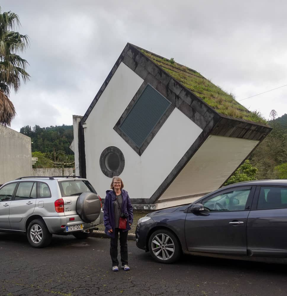 Person cars inverted house Furnas Sao Miguel