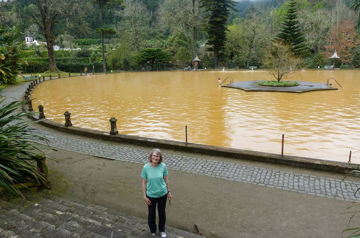 Person foreground Terra Nostra Thermal Pool background