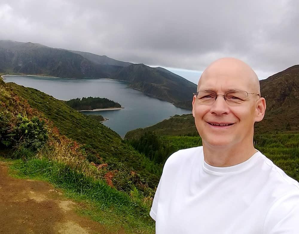 Person with Lagoa do Fogo background