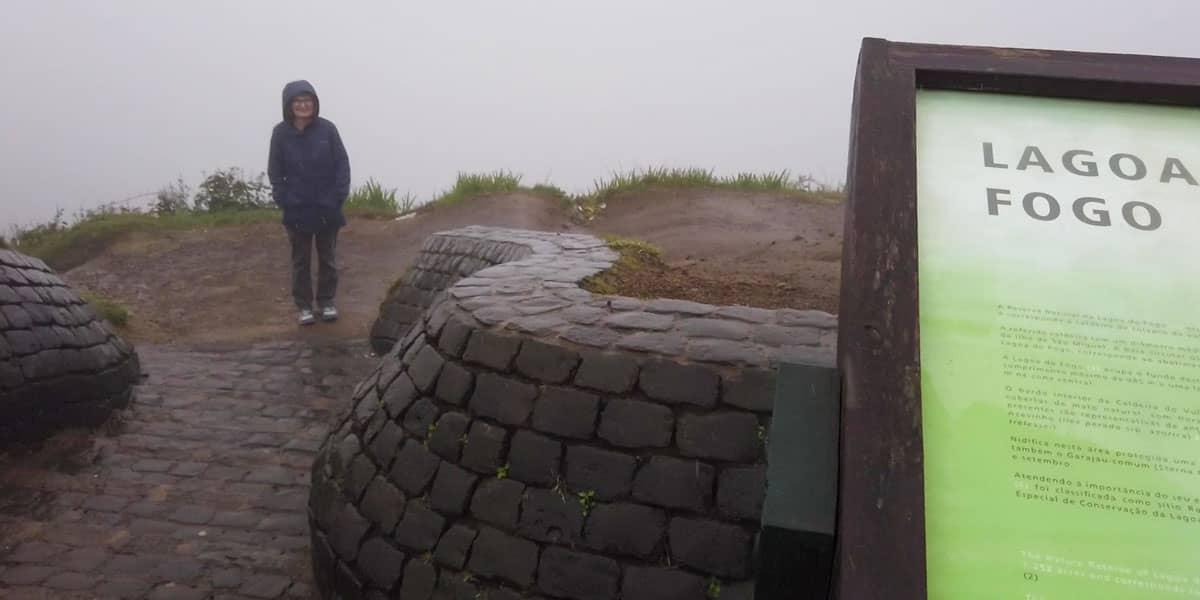 Person standing in fog at Miradouro da Barrosa