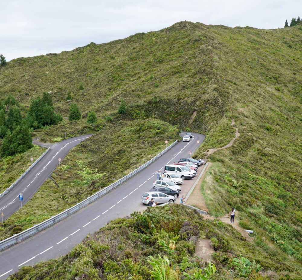 Cars parked along road at Lagoa do Fogo Viewpoint