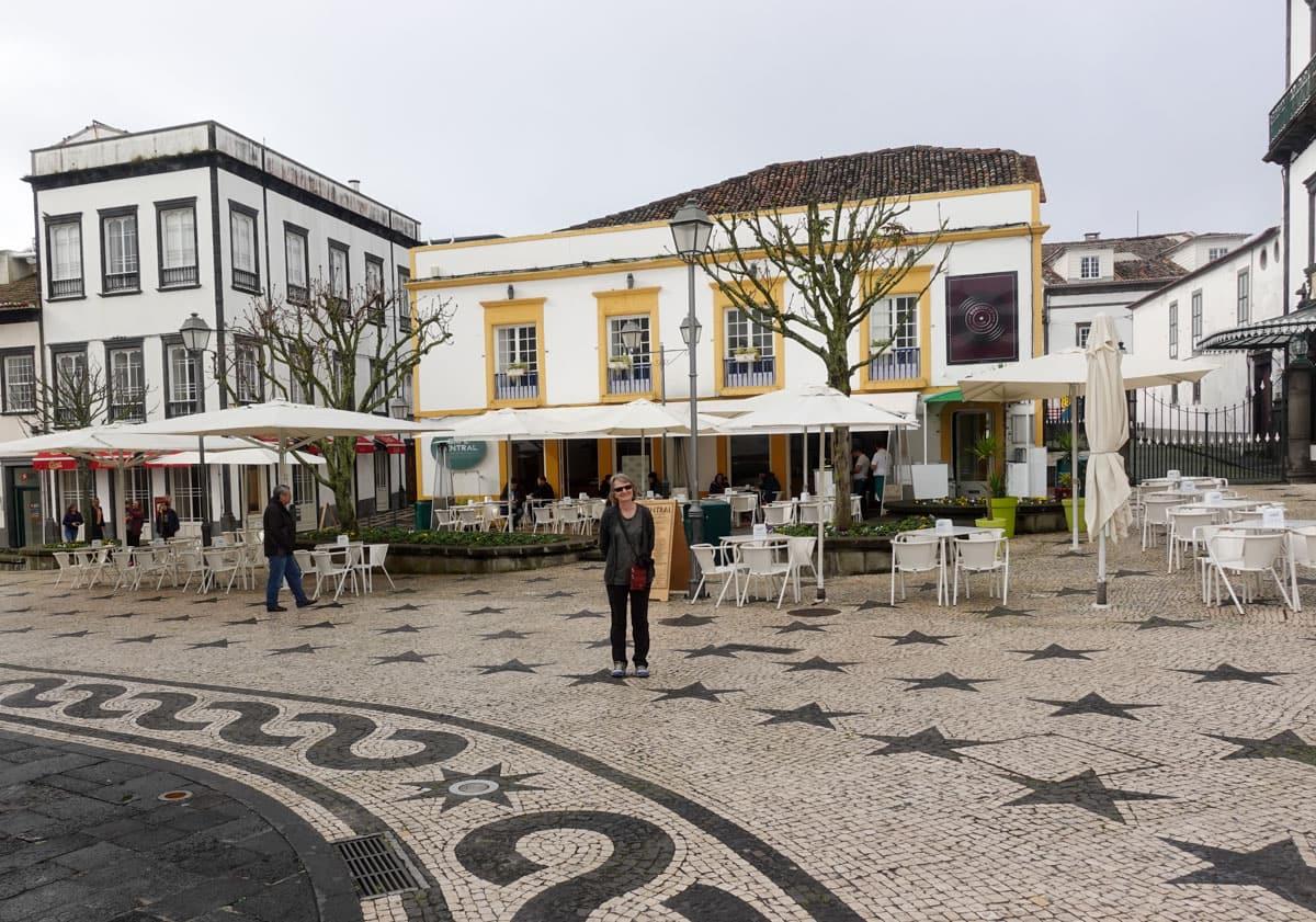 Woman Ponta Delgada cafe tables