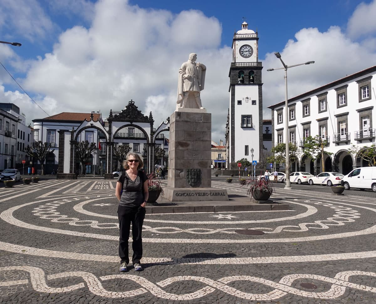 Woman statue clock tower City Gate Ponta Delgada