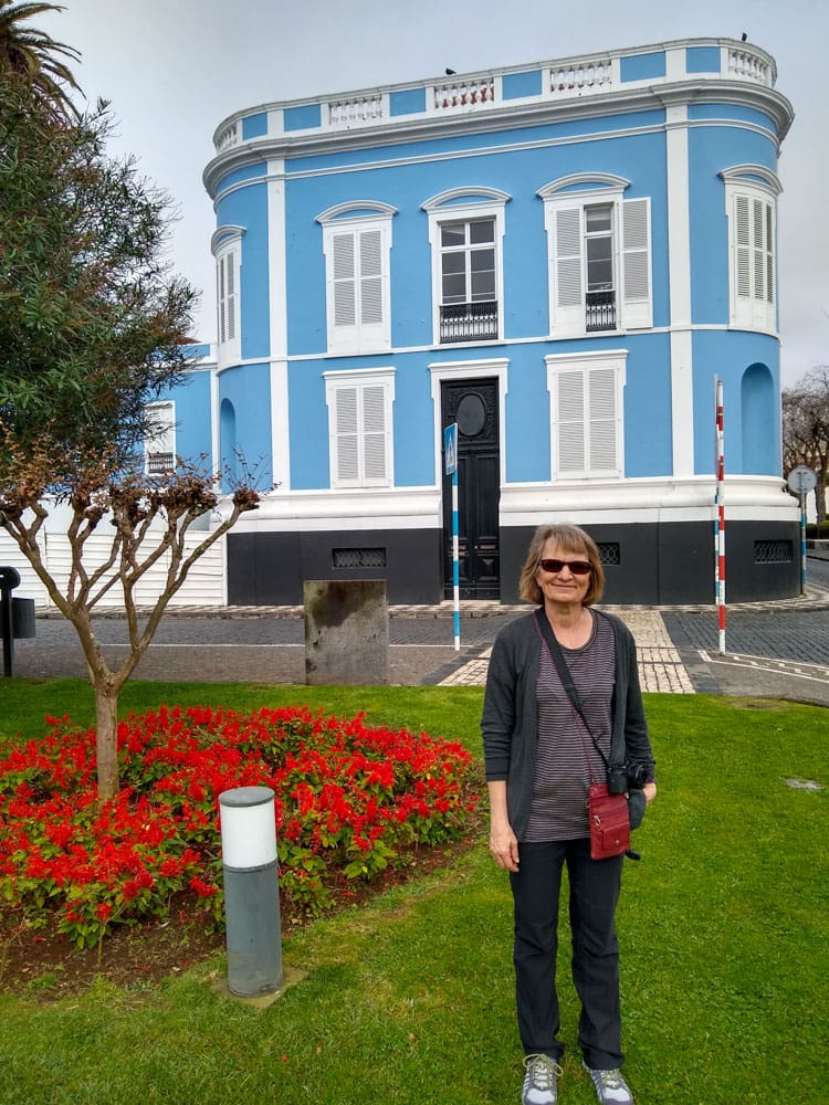 Woman flowerbed Conceicao Palace