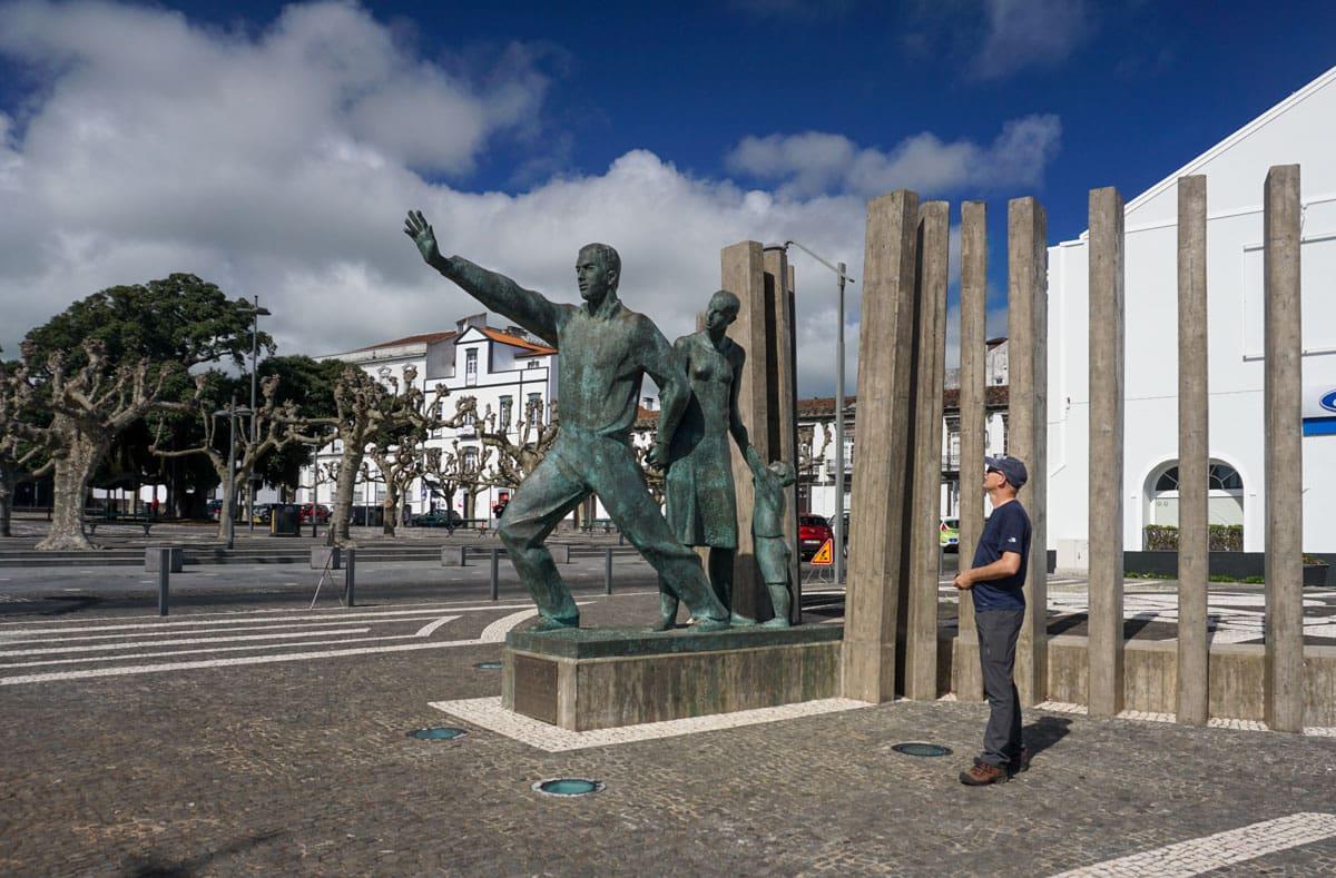 Man looking at Emigrant Monument Ponta Delgada