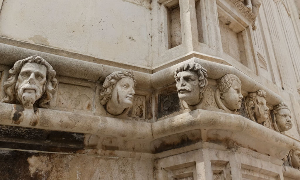 Carved heads along wall of Saint James Cathedral
