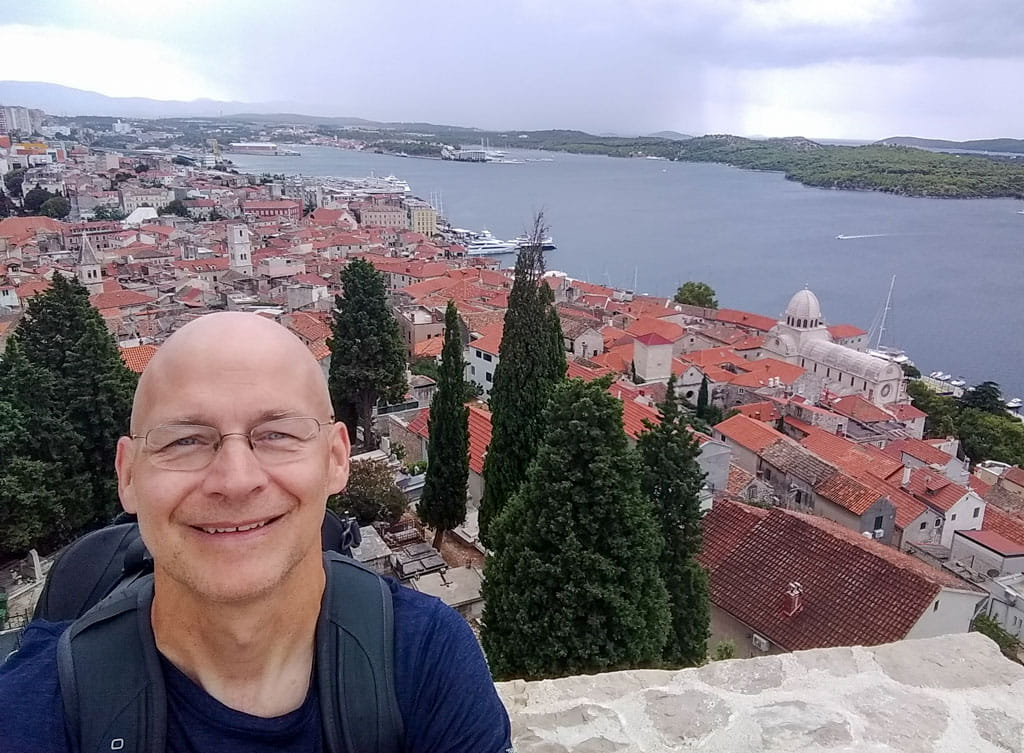 Person overlooking Sibenik and St. Anthony Channel