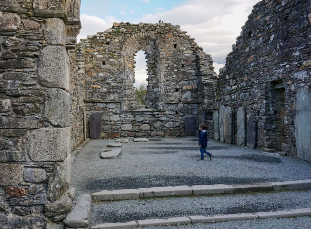 Child explores chancel of Glendalough Monastery Cathedral