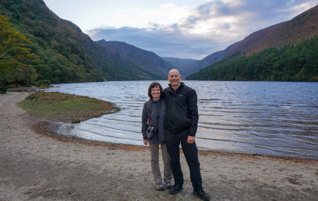 Couple stands in front of Glendalough's Upper Lake