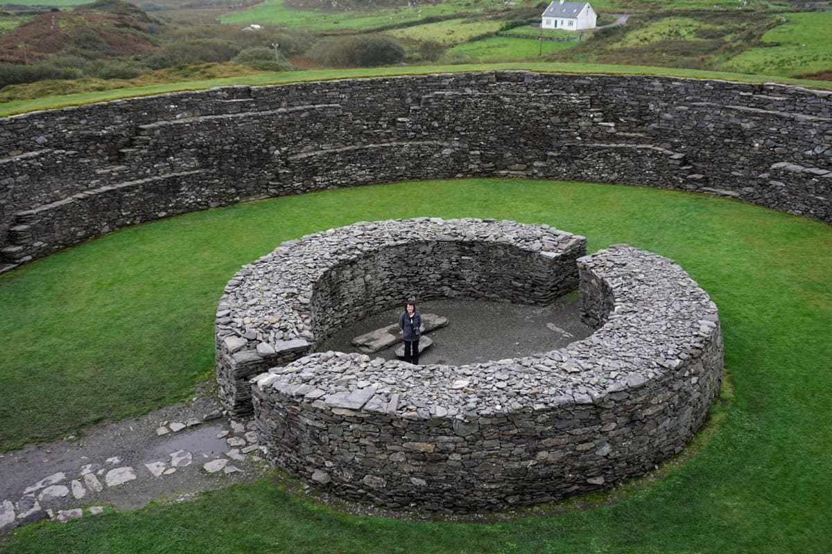 Person center of circular stone structure Cahergall Stone Fort