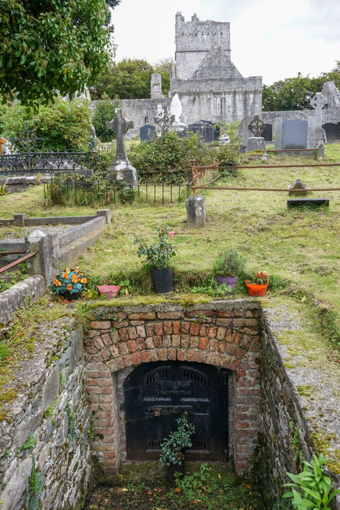 Cemetery's underground crypt entrance Muckross Abbey background